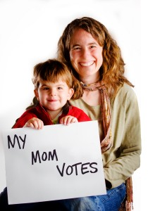 """Mom and son holding """"My Mom Votes"""" sign."""